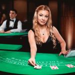 blackjack table with female dealer